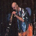 Playing didgeridoo on stage at Health and Harmony 2000.